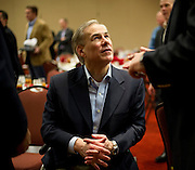 Texas Attorney General Greg Abbott speaks with visitors during the Texas State Rifle Association convention on Saturday, February 23, 2013 in Mesquite, Texas. (Cooper Neill/The Dallas Morning News)