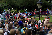A peloton of triathletes run through London's Hyde Park for the Mens' Triathlon competition in Hyde Park during the London 2012 Olympics, the 30th Olympiad. The Triathlon competitors raced over a 1.5km swim, a 43km bike race and a 10km run - eventually won by Team GB's Alistair Brownlee, Spain's Javier Gomez and Jonathan Brownlee (brother of the winner). The venue was the Hyde Park 142 hectares (350 acres) Hyde Park in the heart of the capital, one of the largest parks in central London and the site of the Victorian Great Exhibition of 1851.