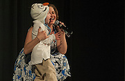 """Paxton Peterson and mother Dr. Brittany Peterson, assistant professor in the School of Communication Studies, sing """"Let it Go"""" from the film, """"Frozen"""" during the talent portion of the Ava Nichols Faculty Pageant in Baker Ballroom on Wednesday, February 25."""