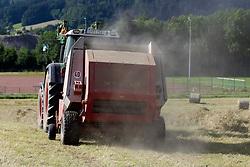 THEMENBILD - Heuernte, Landwirt mit Traktor beim Heuballenpressen, Ballenpressen, aufgenommen in Winden, Deutschland am 24. Juni 2015. EXPA Pictures © 2015, PhotoCredit: EXPA/ Eibner-Pressefoto/ Fleig<br /> <br /> *****ATTENTION - OUT of GER*****