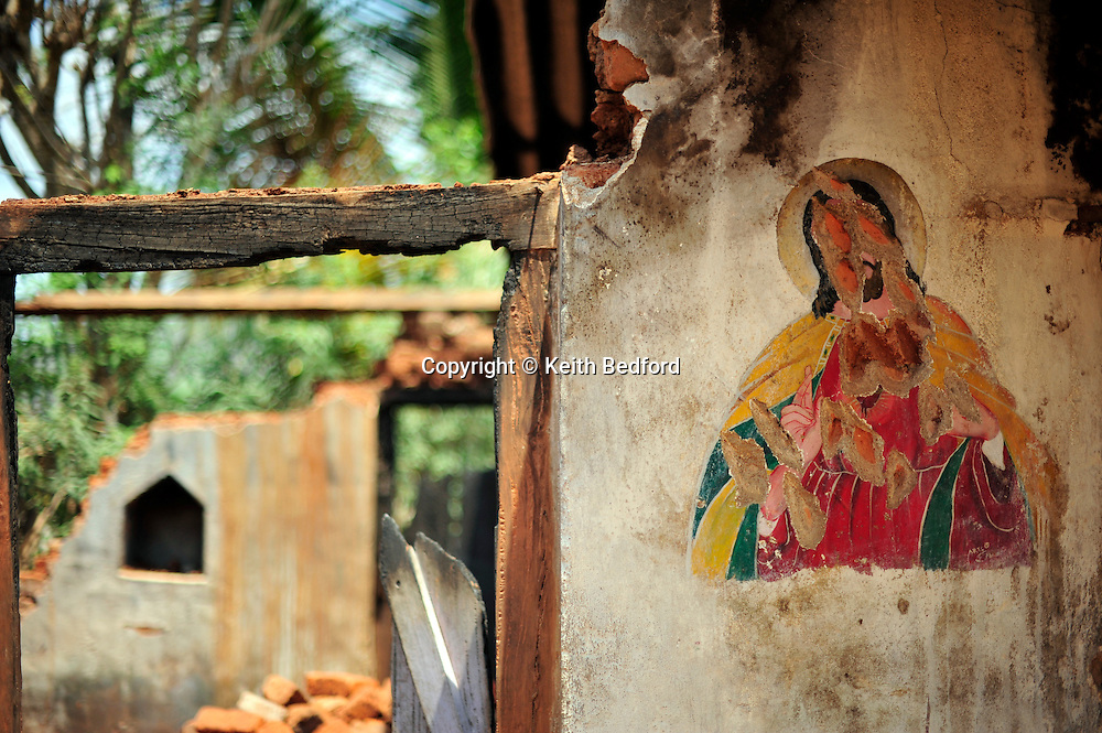 A damaged image of Christ hangs on a wall of a home tht was destroyed during secular violence April 10, 2009 in the town of Mondesore in the state of Orissa, India. Tensions remain high in the area several months after violence by Hindu fundamentalist towards the Christian minority  forced thousands from their homes and leaving several churches and homes destroyed.
