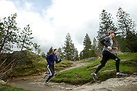 Steve Litalien and Alyssa Kimm jog on the west side of Tubbs Hill as a break in the cloud cover allows a moment of sunlight to shine through Tuesday.