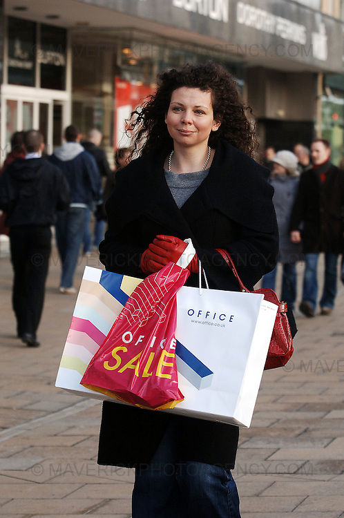 The last Sunday shopping day before Christmas appeared to fail to bring Christmas shoppers out in force on Princes Street in Edinburgh despite shops offering up to 50% on selected stock. ..Pic shows Donna Hamilton from Edinburgh finishing off her Christmas shopping on Princes Street in Edinburgh.