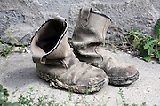 old boots with dried up mud