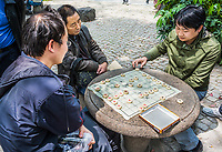 Shanghai, China - April 7, 2013: people playing Xiangqi  chinese chess in people's park at the city of Shanghai in China on april 7th, 2013