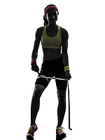 one woman exercising fitness measuring legs with tape measure in silhouette on white background