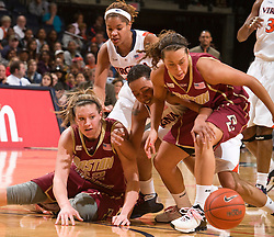 Virginia forward Lyndra Littles (1) battles with Boston Coll. forward/center Stefanie Murphy (32) and guard Corey Rusin (21) for a loose ball.  The #21 ranked Virginia Cavaliers defeated the Boston College Eagles 90-70 at the John Paul Jones Arena in Charlottesville, VA on February 22, 2009.