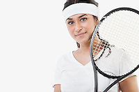 Portrait of young Asian woman with tennis racket against white background