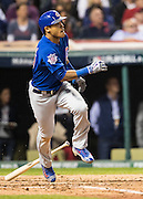 CLEVELAND, OH - NOVEMBER 1, 2016: Addison Russell #27 of the Chicago Cubs hits a grand slam in the top of the third inning bringing home teammates Kyle Schwarber #12, Anthony Rizzo #44, and Ben Zobrist #18 during Game 6 of the 2016 World Series against the Cleveland Indians at Progressive Field on November 1, 2016 in Cleveland, Ohio. (Photo by Jean Fruth)