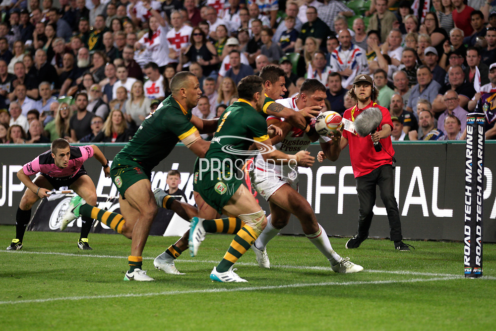 Ryan Hall of England takes control of the ball in front of the Australian defence during the Rugby League World Cup match between Australia and England at Melbourne Rectangular Stadium, Melbourne, Australia on 27 October 2017. Photo by Mark  Witte.