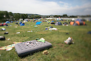 26.06.14 GLASTONBURY FESTIVAL, ENGLAND. Glastonbury Festival Tilt-Shift Feature - An interesting and unique view of last years festival through the eye of a tilt-shift lens. <br /> Pictured: Rubbish is left behind after all the revellers have left at the end of the festival. Rick Findler / Story Picture Agency