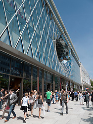 Busy street outside new futuristic architecture  of MyZeil shopping mall in Frankfurt Germany