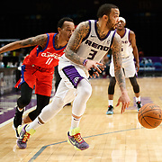 Reno Bighorns Guard MARCUS WILLIAMS (3) drives away from Agua Caliente Clippers Guard TIM QUARTERMAN (11) during the NBA G-League Basketball game between the Reno Bighorns and the Agua Caliente Clippers at the Reno Events Center in Reno, Nevada.