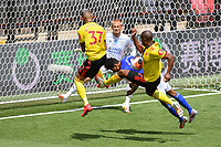 Football - 2019 / 2020 Premier League - Watford vs. Leicester City<br /> <br /> Leicester City's James Justin battles with Watford's Roberto Pereyra and Ismaïla Sarr, at Vicarage Road.<br /> <br /> COLORSPORT/ASHLEY WESTERN
