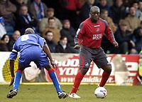 Photo: Olly Greenwood.<br />Gillingham v Swansea City. Coca Cola League 1. 25/03/2006. Swansea Adebayo Akinfenwa takes on Gillinghams Brent Sancho.