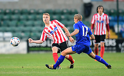 Lincoln City's Archie Moyses vies for possession with Leicester City's Kieran Dewsbury-Hall<br /> <br /> Lincoln City under 18s Vs Leicester City under 18s at Sincil Bank, Lincoln.<br /> <br /> Picture: Chris Vaughan/Chris Vaughan Photography<br /> <br /> Date: July 28, 2016