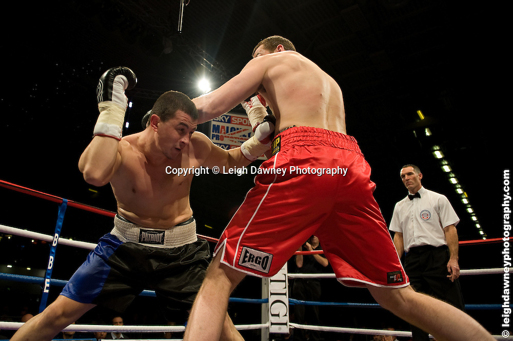 David Price (red shorts) defeats Yavor Marinchev at the Bolton Arena, Bolton, UK on 23rd September 2009. Frank Maloney Promotions. Photo credit © Leigh Dawney