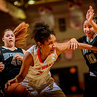 Gallup Bengal Ni'asia Mcintosh (34), center dribbles away from Miyamura Patriot Gabby Olivar (45), left, and Sarah Gilmore (10) during the John Lomasney Invitational basketball tournament at Gallup High School Friday.