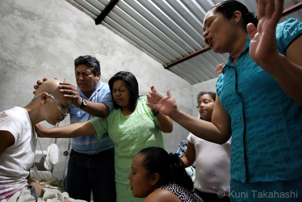 Members of a local church pray for Mariana de la Torre, 29, left, at the house of Mariana's family in Apatzingan, Mexico on March 8, 2009.<br /> (Photo by Kuni Takahashi)