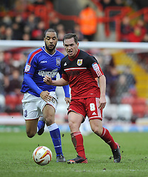 Bristol City's Neil Kilkenny battles for the ball with Ipswich Town's David McGoldrick - Photo mandatory by-line: Joe Meredith/JMP  - Tel: Mobile: 07966 386802 - 26/01/2013 - Bristol City v Ipswich Town - SPORT - FOOTBALL - Championship -  Bristol  - Ashton Gate Stadium -