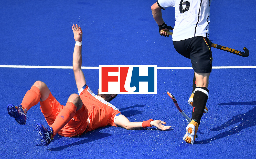 Netherlands' Rogier Hofman (L) falls down beside Germany's Martin Haner during the men's Bronze medal field hockey Netherlands vs Germany match of the Rio 2016 Olympics Games at the Olympic Hockey Centre in Rio de Janeiro on August 18, 2016. / AFP / MANAN VATSYAYANA        (Photo credit should read MANAN VATSYAYANA/AFP/Getty Images)