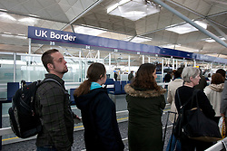 © licensed to London News Pictures. London, UK FILE PICTURE DATED 08/04/2012. Passengers waiting in the queue outside the UK Border of Stansted Airport, this afternoon (08/04/12) . Photo credit: Tolga Akmen/LNP