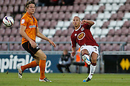 Picture by David Horn/Focus Images Ltd +44 7545 970036.30/08/2012.Man of the Match, Luke Guttridge (right) of Northampton Town and Bjorn Sigurdarson of Wolverhampton Wanderers during the Capital One Cup match at Sixfields Stadium, Northampton.