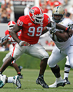 Georgia DE Charles Johnson breaks through the line of scrimmage during the game between the University of Georgia Bulldogs and University of Alabama-Birmingham (UAB) Blazers at Sanford Stadium in Athens, GA on September 16, 2006.  The Bulldogs beat the Blazers 34-0.