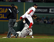 Mark Bellhorn throws to first to complete the doubleplay.  2004 Boston Red Sox, make a run at history getting through a tough fight with the New York Yankees and then eventually sweeping the St. Louis Cardinals for the World Series title.