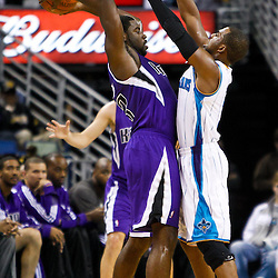 December 15, 2010; New Orleans Hornets point guard Chris Paul (3) guards Sacramento Kings point guard Tyreke Evans (13) during the first half at the New Orleans Arena.  Mandatory Credit: Derick E. Hingle