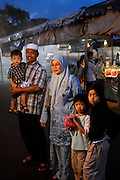 Moslem family at night market, Bandar Seri Begawan, Brunei