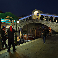VENICE, ITALY - DECEMBER 08:  Gondoliers wait for customers near a Christmas decorated Rialto Bridge on December 8, 2011 in Venice, Italy. HOW TO LICENCE THIS PICTURE: please contact us via e-mail at sales@xianpix.com or call our offices in London   +44 (0)207 1939846 for prices and terms of copyright. First Use Only ,Editorial Use Only, All repros payable, No Archiving.© MARCO SECCHI