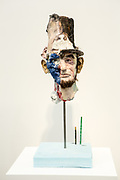 New York, NY - 5 May 2017. The opening day of the Frieze Art Fair, showcasing modern and contemporary art presented by galleries from around the world, on Randall's Island in New York City. A creepy mixed-media head of Abraham Lincoln by David Altmejd in the gallery of Xavier Hufkens.