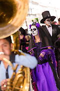 Revelers in Catrina costumes celebrating the Day of the Dead festival known in Spanish as Día de Muertos at the town square October 31, 2013 in Oaxaca, Mexico.  The festival celebrates the lives of those that died.