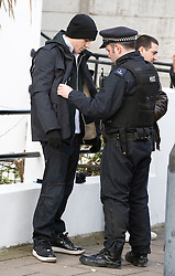 © Ben Cawthra. 28/01/2012.  Football supporters being searched by police before the Barclays Premiership football match between QPR and Chelsea. Security has been heightened due to tensions between the clubs following an on field alleged racial incident. Photo credit : Ben Cawthra