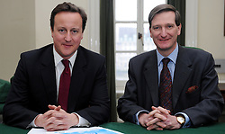 Leader of the Conservative Party David Cameron with Dominic Grieve, Member of Parliament for Beaconsfield in his office in Norman Shaw South, January 5, 2010. Photo By Andrew Parsons / i-Images.