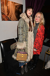 Left to right, Zara Martin and Erica Bergsmeds at an exhibition of photographs by Erica Bergsmeds held at The Den, 100 Wardour Street, London England. 19 January 2017.