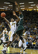 February 2 2011: Iowa Hawkeyes forward Melsahn Basabe (1) puts up a shot while Michigan State Spartans forward Delvon Roe (10) defends during the first half of an NCAA college basketball game at Carver-Hawkeye Arena in Iowa City, Iowa on February 2, 2011. Iowa defeated Michigan State 72-52.