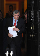 © under license to London News Pictures. 11/05/10. Gordon Brown emerges into the street, carrying his resignation speech, to applause from staff inside number 10 Downing Street. British Prime Minister Gordon Brown has resigned his position and David Cameron has become the new British Prime Minister on May 11, 2010. The Conservative and Liberal Democrats are to form a coalition government after five days of negotiation. Photo credit should read Stephen Simpson/LNP