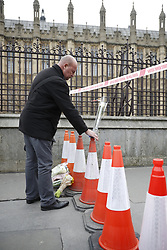© Licensed to London News Pictures.23/03/2017.London, UK.   Flowers are placed on Westminster  Bridge as it is opened the day after a lone terrorist killed 4 people and injured several more, in an attack using a car and a knife. The attacker managed to gain entry to the grounds of the Houses of Parliament, killing one police officer.Photo credit: Peter Macdiarmid/LNP