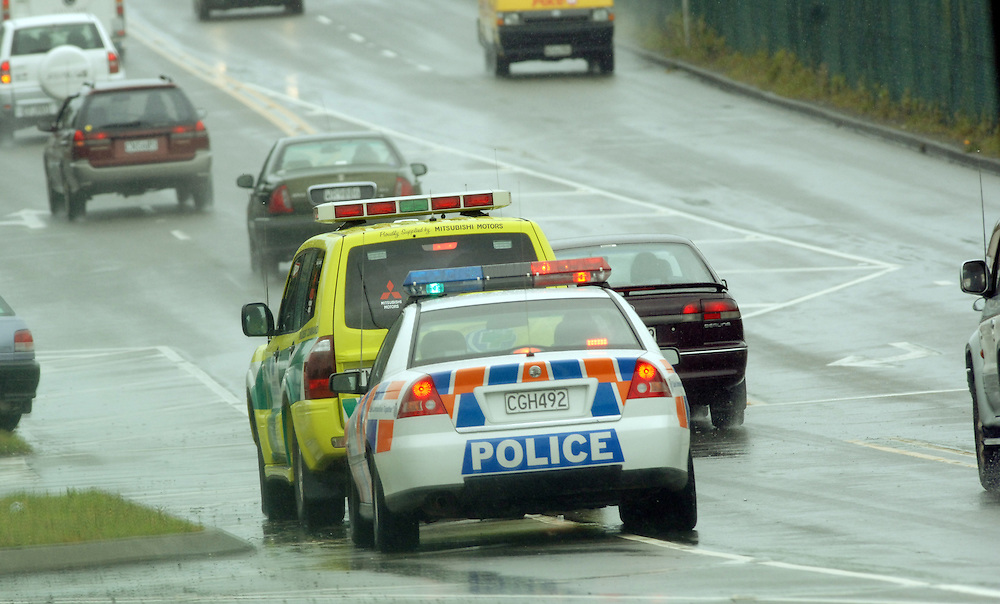 Police car in wet conditions at the airport, Wellington, New Zealand, Tuesday, October 24, 2006.Credit:SNPA / Ross Setford