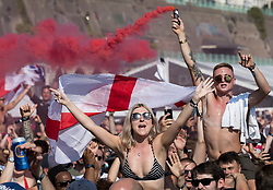 © Licensed to London News Pictures. 07/07/2018. Brighton, UK. Football fans on the sea front in Brighton celebrate England's 2-0 quarter-final win over Sweden at the Russian World Cup. Photo credit: Peter Macdiarmid/LNP