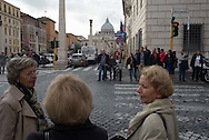Woman talk while waiting at a crosswalk near the Vatican
