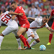 Ricki Lambert , Liverpool, is tackled by Michele Somma, AS Roma, during the Liverpool Vs AS Roma friendly pre season football match at Fenway Park, Boston. USA. 23rd July 2014. Photo Tim Clayton