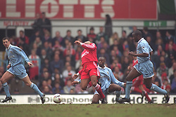COVENTRY, ENGLAND - Saturday, April 6, 1996: Liverpool's JohN Barnes is tackled by Coventry City's Peter Ndlovu during the Premiership match at Highfield Road. Coventry won 1-0. (Pic by David Rawcliffe/Propaganda)