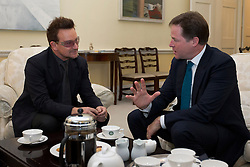 © Licensed to London News Pictures. 11/10/2012. LONDON, UK. U2 singer Bono (R) talks with the British Deputy Prime Minister Nick Clegg as the pair meet to discuss international development issues in Whitehall, London, today (11/10/12). Photo credit: Matt Cetti-Roberts/LNP