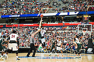 29 MAR 2015: Gavin Schilling (34) of Michigan State University tips off against Mangok Mathiang (12) of the University of Louisville during the 2015 NCAA Men's Basketball Tournament held at the Carrier Dome in Syracuse, NY. Michigan State defeated Louisville 76-70 to advance. Brett Wilhelm/NCAA Photos
