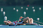 Aiguebelette, FRANCE.  DEN LM1X. Steffen JENSEN stretches out in his single before his time trial heat. Friday Morning Time Trials at the  Friday Morning Time Trials at the 2014 FISA World Cup II, 08:58:02  Friday  20/06/2014. [Mandatory Credit; Peter Spurrier/Intersport-images]