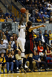 Jan 14, 2012; Berkeley CA, USA;  California Golden Bears forward Bak Bak (15) shoots over Utah Utes forward Blake Wilkinson (25) during the second half at Haas Pavilion. California defeated Utah 81-45. Mandatory Credit: Jason O. Watson-US PRESSWIRE