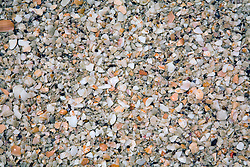 Guanacaste Province:  Conchal Beach (Playa Conchal) on the central Pacific coast.  Conchal is known for its variety of colored sand, made up primarily of broken bits of shell such as shown in this image.